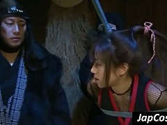 Tied up Jap slave gets tortured by two ninjas