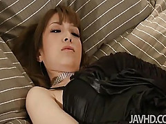 Yurias black satin dress turns her on so much that she has to strip and play with herself.