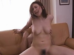 Big Titted MILF Suyuki Kanno Fucks A Guy On The Couch